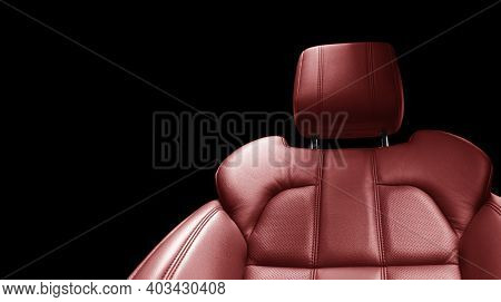 Modern Luxury Car Red Leather Interior. Part Of Red Perforated Leather Car Seat Details With White S