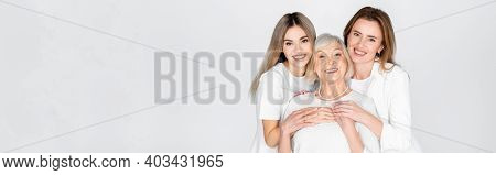 Three Generation Of Happy Women Smiling While Looking At Camera Isolated On Grey, Banner
