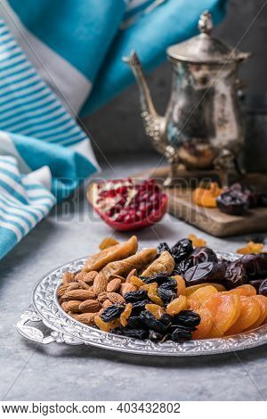 Assortment Of Nuts And Dried Fruits. Dried Fruits And Nuts Mix In A Wooden Bowl. Assortment Of Candi