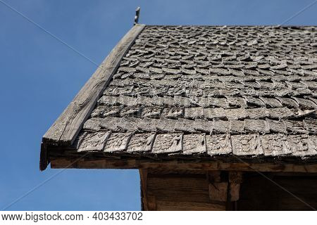 A Shingle Roof In Lithuania, Zalgiris Village. Traditional Roofing Of Ancient Houses.