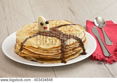 Pile Of Baked Pancakes And Banana Character Lying On Pancakes