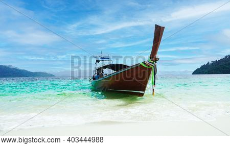 Wooden Fishing Boat On Sea Coast Of Tropical Lipe Island In Thailand At Sunny Day Of Summer Vacation
