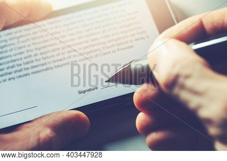 Electronic Signature Concept - Man Sign Distance Contract With Digital Pen In Mobile Phone