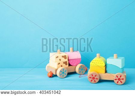 Stacking Train Toddler Toy For Little Children On Blue Background With Shadow Reflection. Baby Train