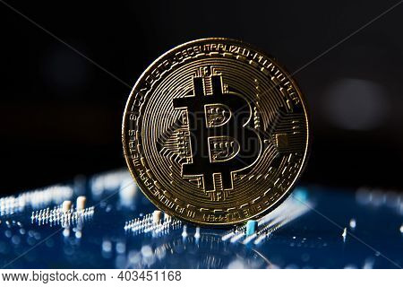 Bitcoin Coin On Blue Circuit Background