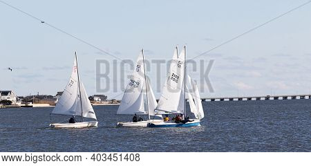 Babylon, New York, Usa - 7 December 2019: Two Person Sailboats In A Winter Regatta In The Great Sout