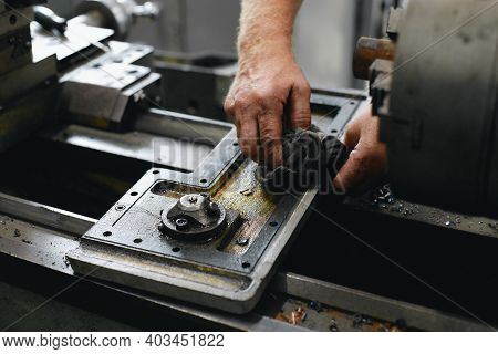 Service And Repair Of Machine Tools In A Machine Shop Or Workshop. These Are The Hands Of A White Ma
