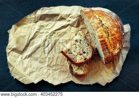 This Is A Loaf Of Fresh Crusty Bread With Cereals On Sourdough. Yeast-free Homemade Cakes Lie On Yel