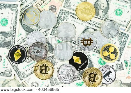 Various Cryptocurrency Coins On Dollars. Bitcoin, Ethereum, Litecoin And Others Modern Virtual Curre