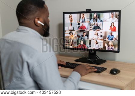 Successful Male Employee At Online Meeting With Multiracial Colleagues, Discuss Work Projects. Busin