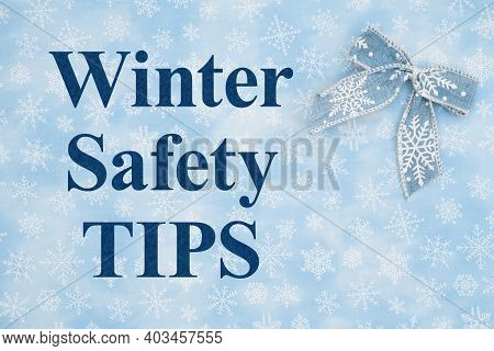 Winter Safety Tips Message With A Blue Bow With White Snowflake On Blue Snowflake Textured Material
