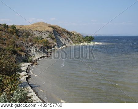 Beautiful River In Summer. High Bank Above The River. High Cliff Above The River
