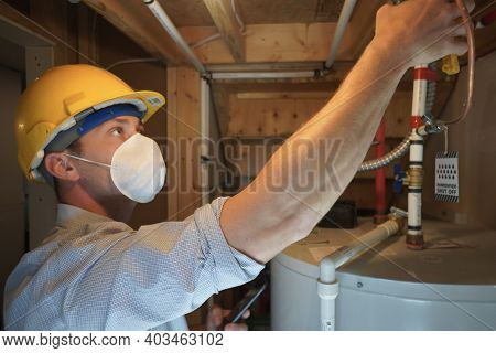 Home Inspection Man Looking At Hot Water Heater