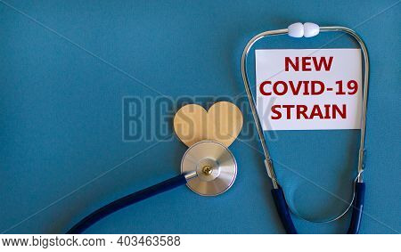 New Covid-19 Strain Symbol. White Card, Words 'new Covid-19 Strain' And Stethoscope, Blue Background