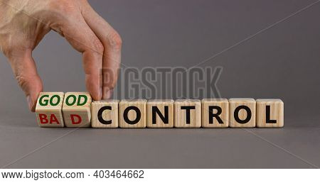 Bad Or Good Control Symbol. Businessman Turns Wooden Cubes And Changes Words 'bad Control' To 'good