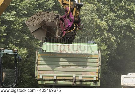 Earthworks With An Excavator In Civil Engineering On A Construction Site