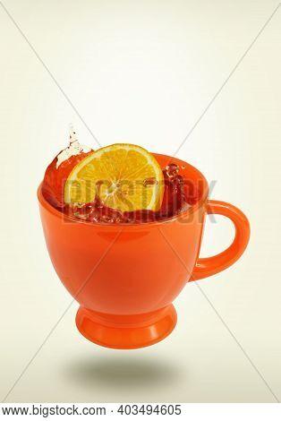 Levitating Orange Teacup With Tea And Lemon