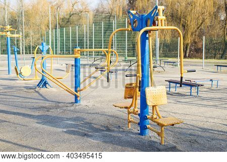 Outdoor Gym In The Public Garden. Outdoor Fitness Equipment In Public Park. Sports Simulators In The