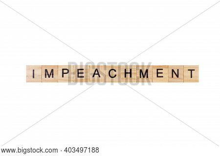 Impeachment. English Word On White Isolated Background Composed From Letters On Wooden Cubes. Learni