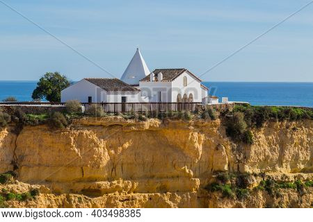 Chapel in the cliffs of Algarve, Portugal