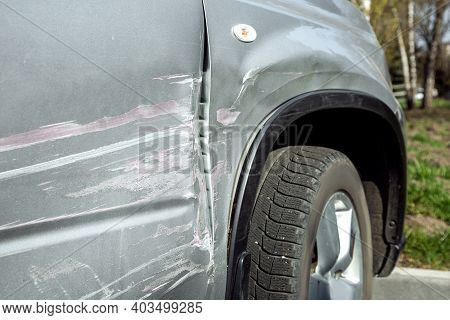 Details Of The Damage To Crash Car In The Incident, A Scratched Door And A Crumpled Fender Close Up