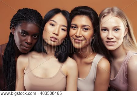 Young Pretty Asian, Caucasian, Afro Woman Posing Cheerful Together On Brown Background, Lifestyle Di