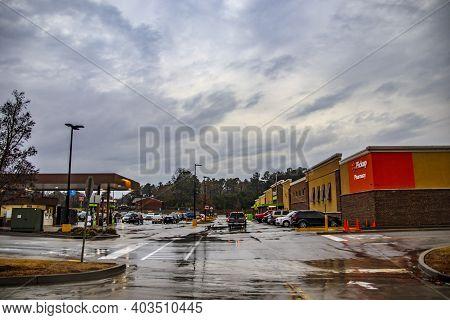 Augusta, Ga Usa - 01 01 21: Walmart Neighborhood Grocery Store In The Rain And Gas Station