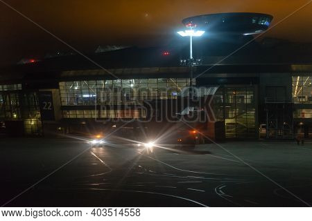 Moscow. Russia. October 2019. Vnukovo Airport On The Night. Airport From The Field Under The Spotlig