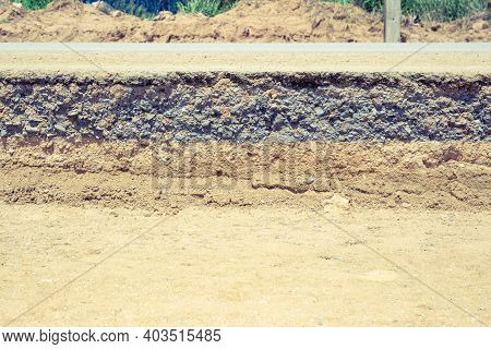 Asphalt Road Cross Section In Repair And Reconstruction Work. To Show Layer Of Surface And Undergrou