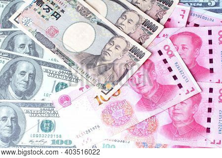 Dollar Money ,usa Banknote ,yuan Banknote ,chinese Banknote And Yen Banknote , Japanese Banknote Lay