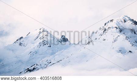 Panoramic View Of Mountains Near Brianson, Serre Chevalier Resort, France. Foggy Winter Mountain Lan