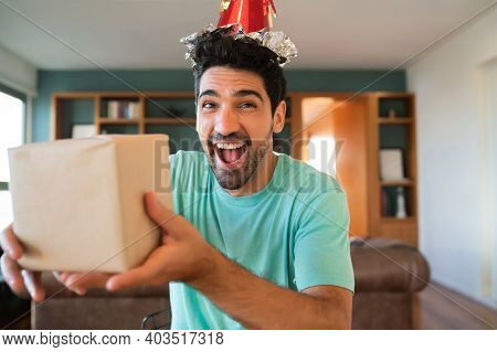 Portrait Of Young Man Celebrating His Birthday