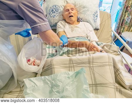 Arm Injury,elderly Man Being Medically Treated At Home,united Kingdom 2021.