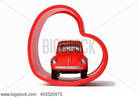 Chelyabinsk, Russia - January 15, 2020: Volkswagen Beetle Toy Red In The Red Heart On White Isolated