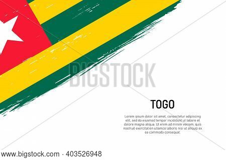 Grunge Styled Brush Stroke Background With Flag Of Togo. Template For Banner Or Poster.