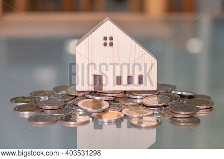Selective Focus At Wooden House Mock Up That Put On The Top Of Growth Money Coins Stack On The Glass