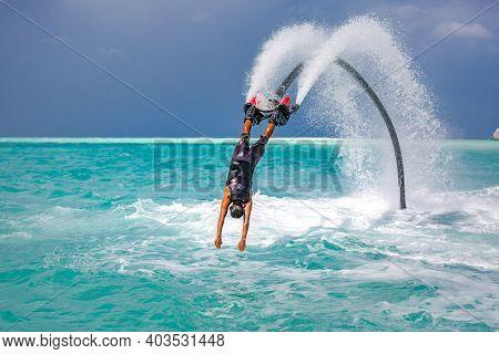 14.12.19, Ari Atoll, Maldives: Professional Pro Fly Board Rider In Tropical Sea, Water Sports Concep