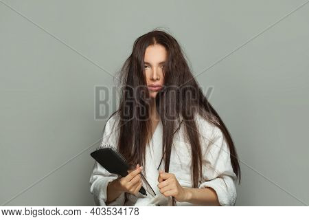 Melancholy Woman Combing Her Tangled Hair In The Morning, Hair Care And Hair Problem Concept