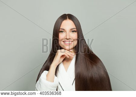 Healthy Woman With Long Straight Hair On White Background