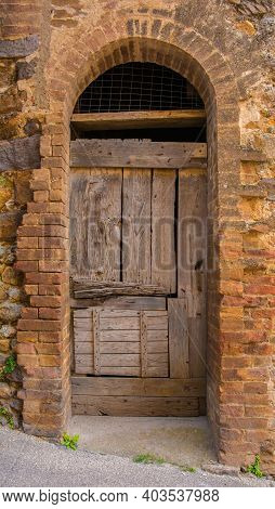 A Door In An Historic Derelict Building In The Medieval Village Of San Lorenzo A Merse Near Monticia