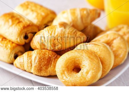 Selection Of Breakfast Pastries On A Plate. High Quality Photo.