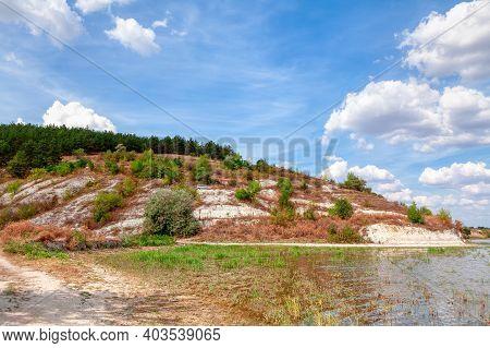 Limestone Hill At The Riverside . Coastal Rocks Scenery