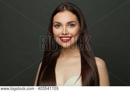 Smiling Brunette Model Long Straight Hair And Cute Smile On Black Background