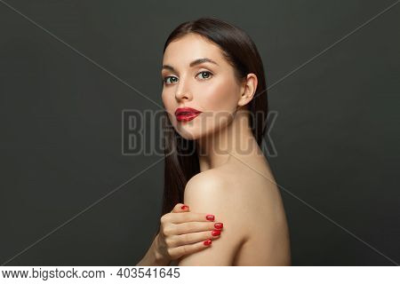 Perfect Young Woman With Clear Skin On Black Background. Skincare And Facial Treatment Concept