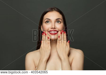Beautiful Fashion Model Woman With Red Manicured Nails On Black Background