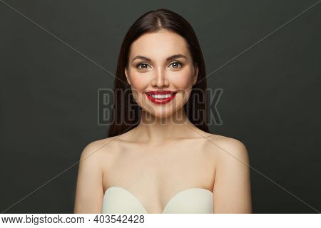 Pretty Young Model Woman With Clear Skin And Long Healthy Straight Hair. Skincare And Facial Treatme
