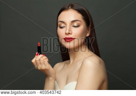Nice Woman With Red Lipstick Makeup On Black Background