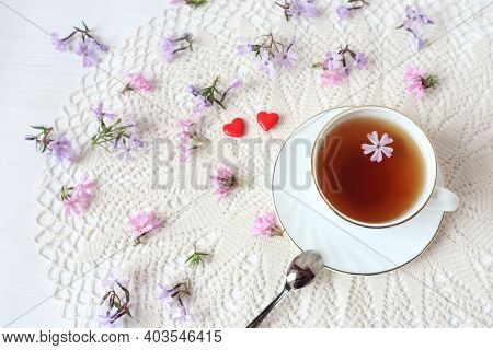 A Cup Of Fragrant Tea With Two Red Hearts On The Background Of A White Openwork Napkin, Delicate Lil