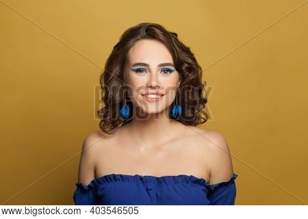 Young Happy Woman With Perfect Curly Bob Hairstyle On Vivid Yellow Background