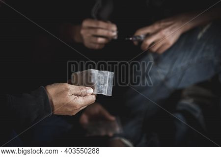 Close Up Teenage Man And Woman Is Taking Heroin, Drug Addict, Disease , No To Drugs,the Concept Of A